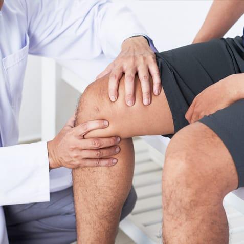 doctor working on patient's knee